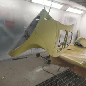 Motorbike repair hanging primed